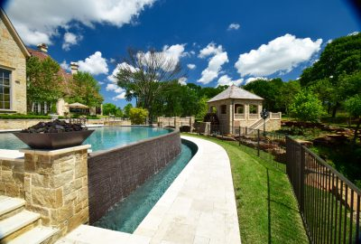 Flower Mound Infinity Pool with Water Wheel